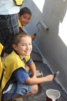 Volunteers paint Monte Vista Elementary School during the 2013 Mormon Helping Hands event.
