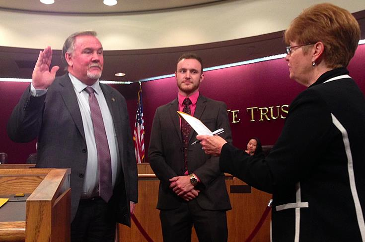 City Clerk Geri K. Bryan (right) administers the oath of office to newly-elected Councilman Marvin Crist as his son, Ryan (center), looks on. Crist was also re-appointed as the city's Vice Mayor by a vote of 4-0. (JIM E. WINBURN)