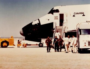 Astronauts John Young and Robert Crippen exit Columbia after landing on Rogers Dry Lake Bed April 14, 1981. (U.S. Air Force photo provided by the Air Force Test Center History Office)