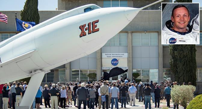 A black cloak is pulled to reveal the new name of NASA's Neil A. Armstrong Flight Research Center to conclude ceremonies May 13 honoring the center's new designation. (NASA photo by Ken Ulbrich)