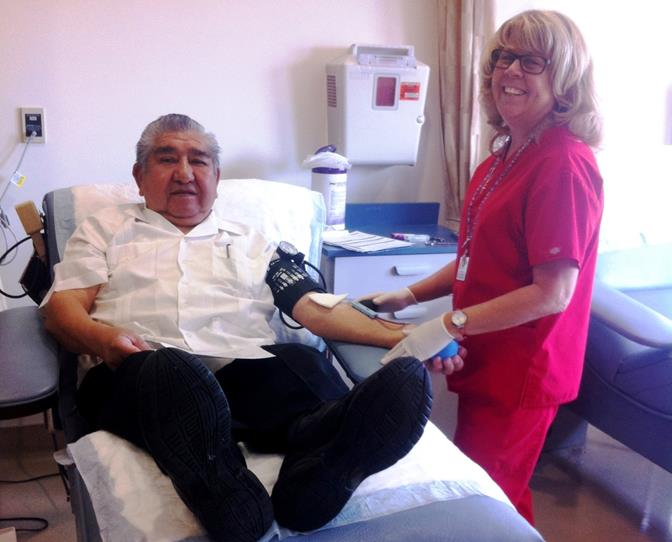 Tony Johnny is assisted by Phlebotomist Joie Bergeon in donating blood at the Church's one-day blood drive. (Contributed photo)