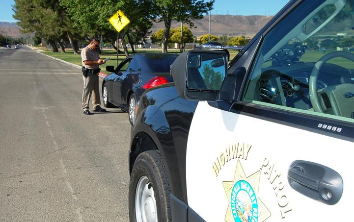 """A female driver was pulled over for rolling through a stop sign near George Lane Park  on 55th Street West and Avenue L-8. She told CHP Officer Gil Hernandez she had a lot on her mind. """"I understand, but right now you need to focus on what you're doing, which is driving,"""" Hernandez told the woman, before letting her off with a warning. """"Is it against the law? Yes. But our goal is educate,"""" Hernandez said."""