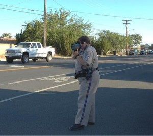 CHP officer Thomas targets speeders in the Quartz Hill Elementary school zone.