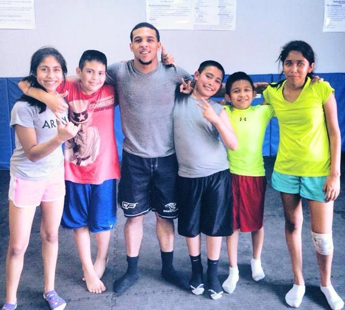 Former Palmdale High School wrestler Donovan Baker (center)  is a long way from the Antelope Valley, but he couldn't stay away from the gym. He now instructs kids  on different wrestling and MMA techniques at the Evolution MMA gym in San Antonio. (Contributed photo)