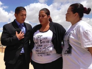 Reflecting and comforting one another outside the Antelope Valley Courthouse are, from left, Dr. Miguel Suarez Coronado, president of Agents of Change; Yadira Mendoza, Giselle's sister; and Norma Sanchez, a family friend. (Photo by JIM E. WINBURN)