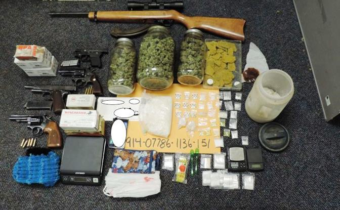 Four handguns, one rifle, five pounds of marijuana, 20 marijuana plants and one pound of methamphetamine packaged for sales were discovered when authorities served a search warrant Thursday at the Lancaster home on the 3500 Block of east Avenue H-4.