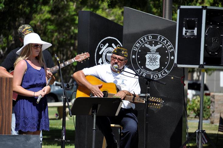 Jordyn Nardini, Larry Pratt and Daniel Pratt performed songs honoring Prisoners of War-Missing in Action at Memorial Day Services at Joshua Memorial Park.