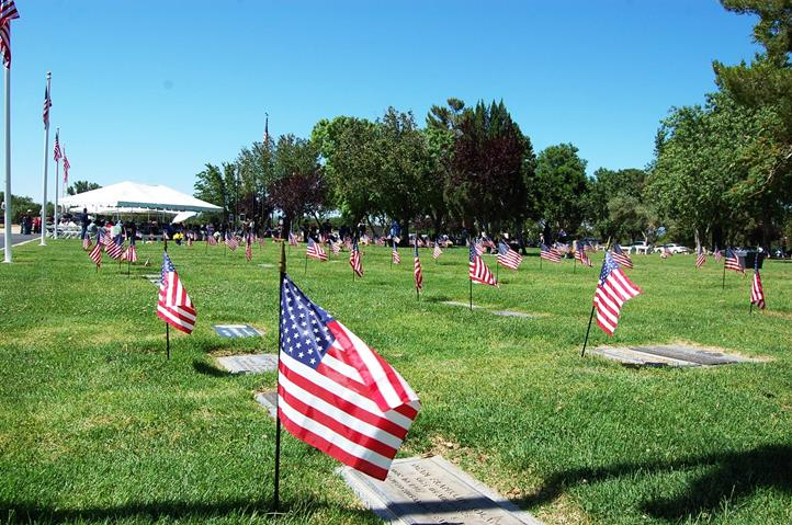 Small American flags were placed alongside veterans' graves at Joshua Memorial Park.