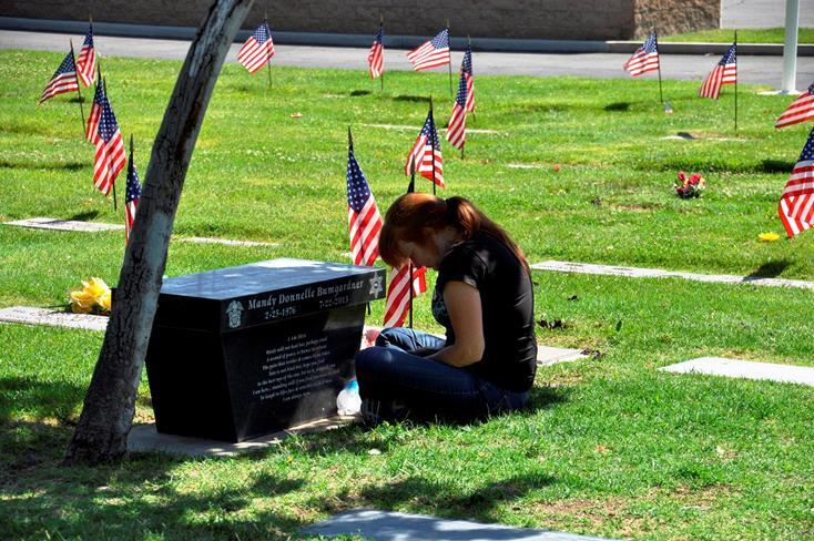 A few took time from the service to personally grieve fallen loved ones.