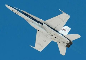 A NASA Armstrong F/A-18 roars over the NASA Armstrong Flight Research Center during ceremonies honoring the center's name change. (Ken Ulbrich)