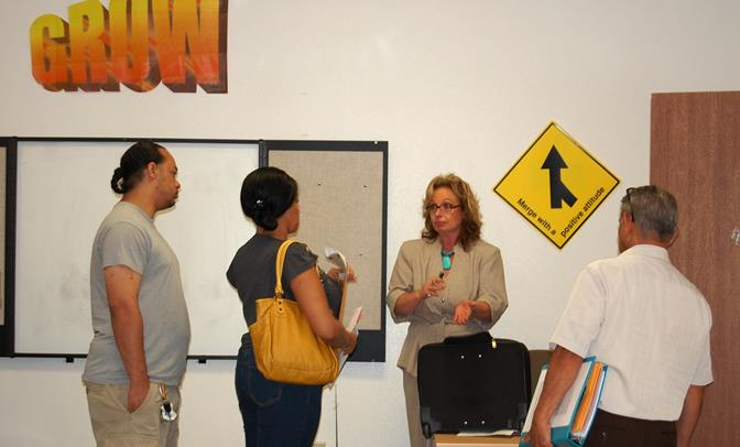 Michelle Egberts (center) speaks with participants at an Expungement Workshop at the Lancaster GROW office. The workshops are offered every Tuesday and Thursday and are free and open to the community.
