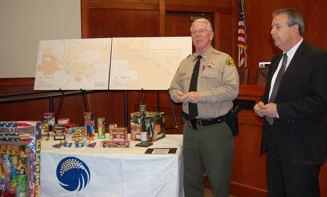 Palmdale Sheriff's Station Captain Don Ford and Palmdale Mayor Jim Ledford discuss examples of illegal fireworks at a fireworks safety press conference Wednesday, June 25.
