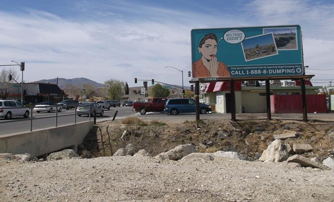 The city launched a billboard ad campaign near dumping hot spots to draw attention to the problem and encourage people to report illegal dumping by calling 1-888-8dumping.