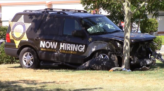An LASD employee was traveling eastbound on Rancho Vista Blvd. before colliding with two vehicles at 30th Street West and then crashing into a tree on the outskirts of Marie Kerr Park. (Photo by JOHN MEZA)