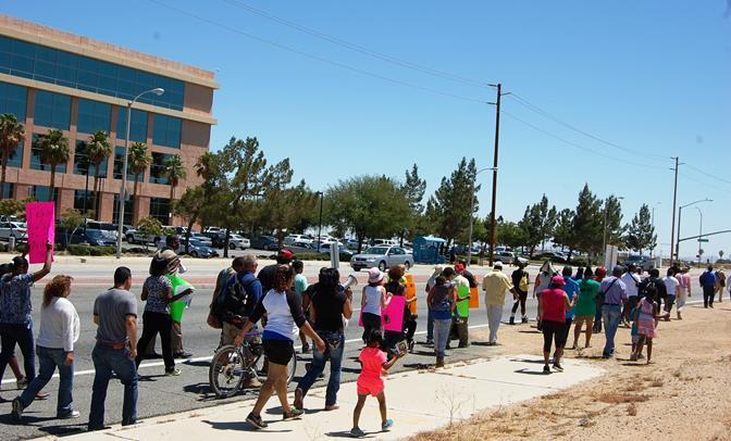 """Protesters taking part in the """"Balancing the Scales of Justice"""" march make their way down Avenue M to the Antelope Valley courthouse Thursday morning."""