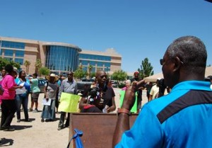 Smith speaks at the rally across from the courthouse, following the march.