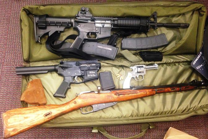 Officials said OSS deputies recovered several guns, which included .22 semi-automatic rifle, disassembled AR-15, pistol-revolver, and a rifle. (Photo courtesy LASD)