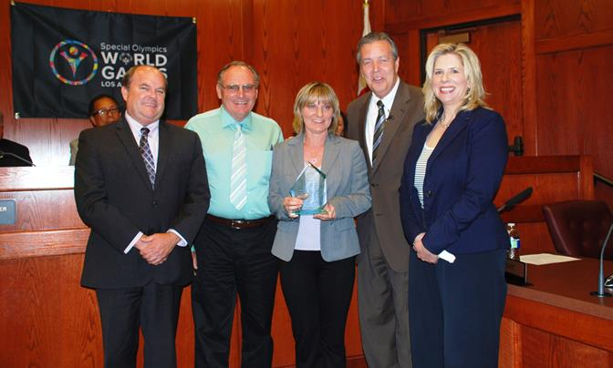 """Administrative Analyst Cheryl Hughes (center) was honored for spearheading the highly successful """"Massari Makeover"""" event held last October. Hughes is pictured with (L to R) Palmdale Director of Public Works Mike Mischel, Superintendent of Maintenance Tony Colombo, Mayor Jim Ledford, and Community Safety Supervisor Kelly Long. (Contributed photo)"""