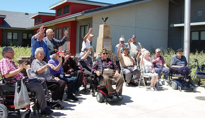 After the brief ceremony, 16 of the Veteran Home's WWII veterans gathered around the monument in their honor.