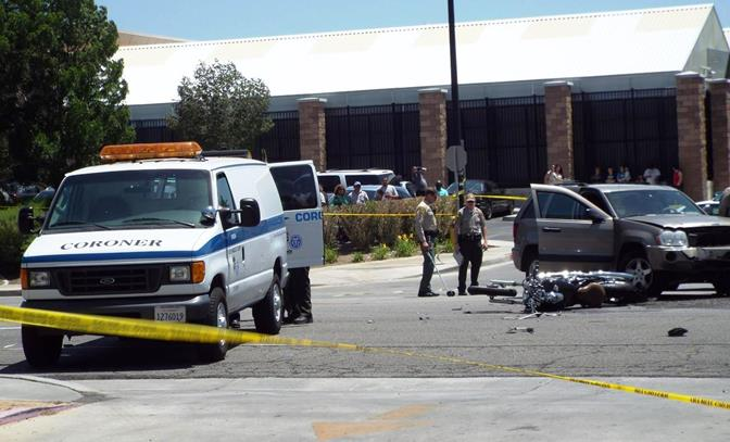 Witnesses at the scene said emergency workers tried for several minutes to revive the motorcyclist but were unsuccessful. He was pronounced dead at the scene. (Photo by JOHN MEZA)