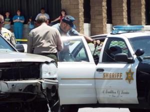 The SUV's driver was taken away in a patrol car. (JOHN MEZA)