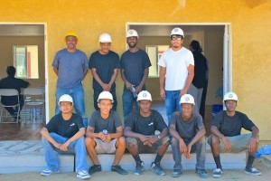 AV YouthBuild students take a break while working at the Supporting Housing Site. (JAMAAL BROWN)