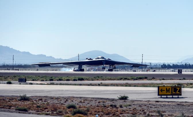 The B-2 Spirit of Arizona made a dramatic landing Thursday, July 17, at U.S. Air Force Plant 42 prior to Northrop Grumman's B-2 25th anniversary ceremony.
