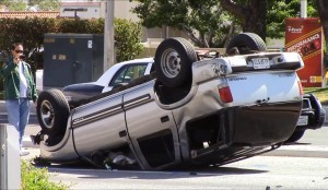 The alleged DUI driver's vehicle flipped over numerous times and stayed flipped over.  (Photo by JOHN MEZA)