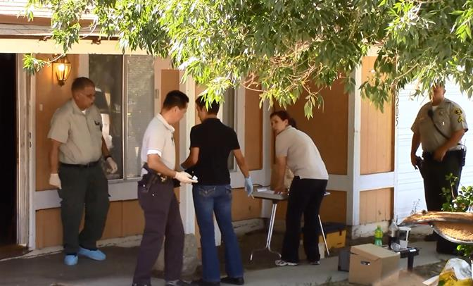 Crime scene investigators converge at the Lake Los Angeles home where a man was found dead early Friday morning. (Photo by LUIS MEZA)