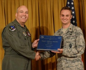 Brig. Gen. Michael Brewer (left), 412th Test Wing commander, presents Maj. Jeffrey Mueller with a plaque from the 412th Test Wing and NASA Armstrong Flight Research Center for his contributions to the LGBT Pride Month luncheon June 26. (U.S. Air Force photo by Rebecca Amber)