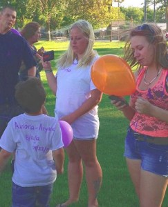 Linda Hollingsworth (center) reflects on Tuesday's celebration of her 20-month-old daughter's life.