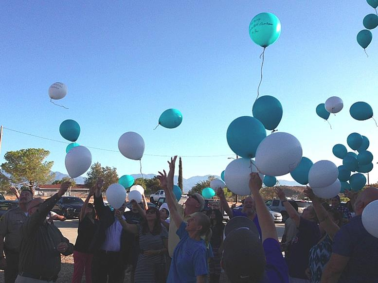 Members of the community release balloons into the sky to remember survivors and victims of sexual assault at the Twin Lakes Community Church in Lake Los Angeles on Friday, Aug. 22.  (Photo by Jim E. Winburn)