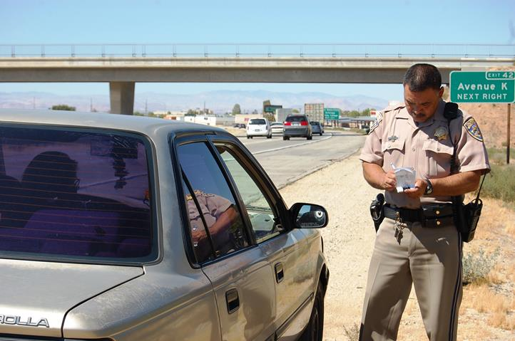"""Around 2:50 p.m., Wednesday, Aug. 27, Chaylene Latanzi was stopped on the northbound 14 Freeway near the Avenue K exit for handling her cell phone while driving. Latanzi said she was on her way to her second job and had picked up her cell phone to connect it to the charger. She acknowledged that doing so was unsafe and definitely not worth it. """"The important thing is that she understands,"""" Hernandez said, adding that educating the public was one of the main reasons for conducting traffic safety operations."""