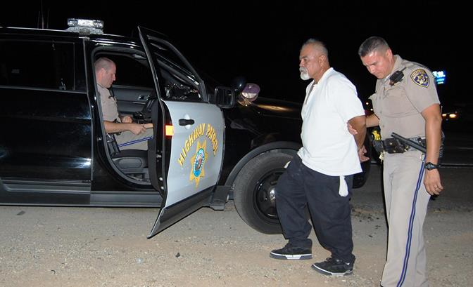 David Morales is taken away by CHP Officer E. Alonzo during a CHP Impaired Driver Task Force Operation Saturday night. Morales has three prior DUI convictions; this was his 4th DUI arrest, according to officers at the scene.