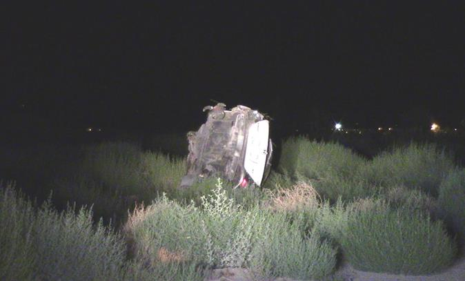 A 2006 Honda Civic skidded off the roadway and flipped several times near the intersection of Avenue K and 90th Street East. The driver, 18-year-old Palmdale resident Joshua Coti, was thrown from his vehicle and killed. (Photo by LUIS MEZA)