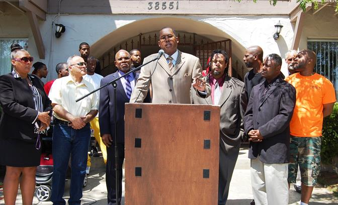 "Ansar ""Stan"" Muhammad speaks at a press conference Friday to address the gang and drug infested apartment complexes along 11th Street East near Avenue Q in Palmdale."
