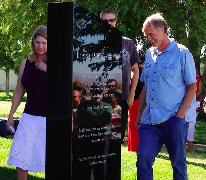Marine Cpl. Ian Stewart's family, Dawn and Dana, examine the newly-unveiled granite memorial dedicated in honor of Cpl. Ian Stewart at Quartz Hill High School on Thursday. (Photo by JIM E. WINBURN)