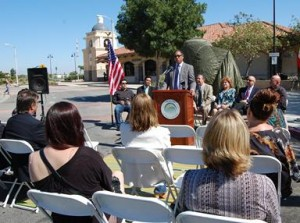 Palmdale City Councilmember Fred Thompson speaks at a ceremony Wednesday to unveil a new piece of public art at the entrance of the Palmdale Transportation Center.
