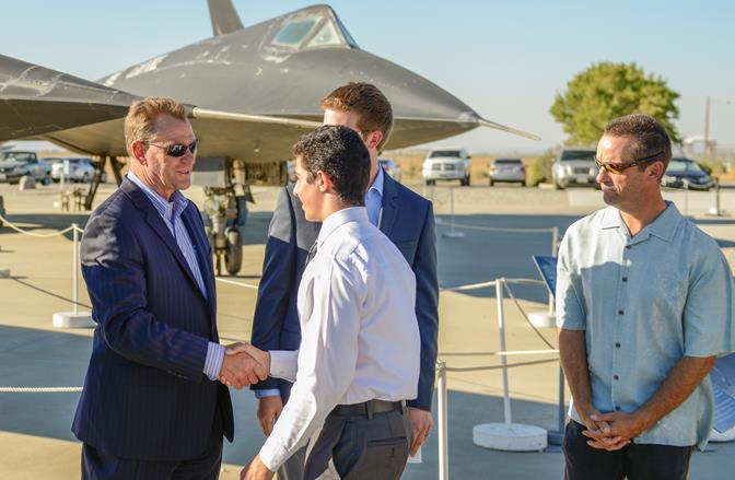 Andy Reynolds, vice president, manufacturing operations and Palmdale site manager, congratulates Los Angeles County Air Show Scholarship recipients, Sean Hormozian, during a recent awards ceremony. (Photo courtesy Northrop Grumman)