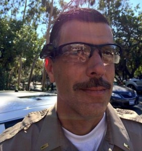 A deputy displays one of the four different types of body cameras being tested. (Courtesy LASD)