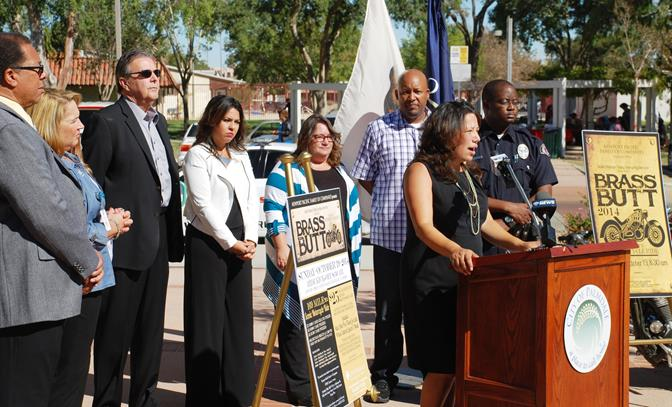 """SAVES Coordinator Patricia Morales discusses the mission of SAVES at a press conference Tuesday to announce the second annual AV """"Brass Butt"""" Charity Ride."""