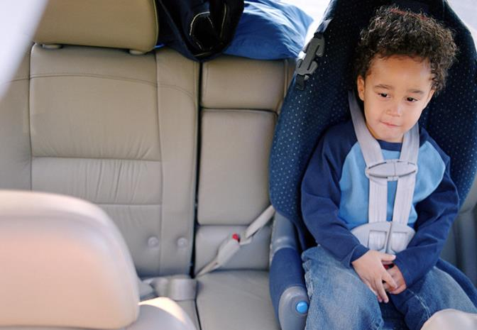 California law requires that children be properly restrained in an appropriate child safety seat in the back seat until they are 8 years old.