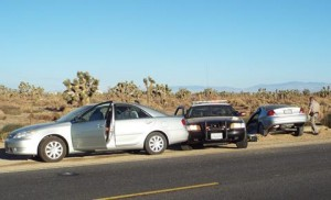 A Toyota Camry was stopped for a vehicle code violation when another car crashed into the CHP vehicle. (LUIS MEZA)