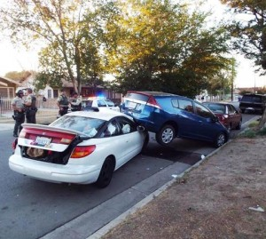 The car chase ended near Date Avenue and Oldfield Street after Carson rounded a corner and crashed into two parked cars. (JOHN MEZA)