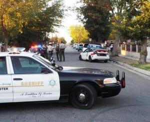Witnesses at the scene said several liquor bottles were removed the white Saturn. (JOHN MEZA)
