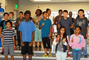 """At the dedication ceremony, Mrs. Thomas' 6th grade class sang the new school song, """"Enterprise Our Home."""""""