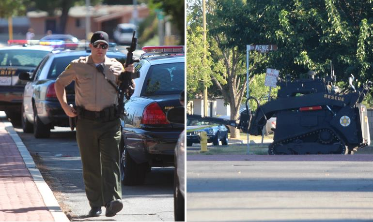 During the more than eight-hour standoff, dozens of deputies swarmed the area near 4th Street East and Avenue J in Lancaster. (Photo by TONY CHEVAL)