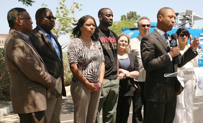 The local meeting this Thursday, Oct. 2 is the result of a community bus ride to a Public Utilities Commission meeting held in Temple City in May 2014, according to Johnathon Ervin, president of the Antelope Valley Community Alliance . Ervin (front) speaks to the media outside the PUC meeting in May. (Contributed photo)