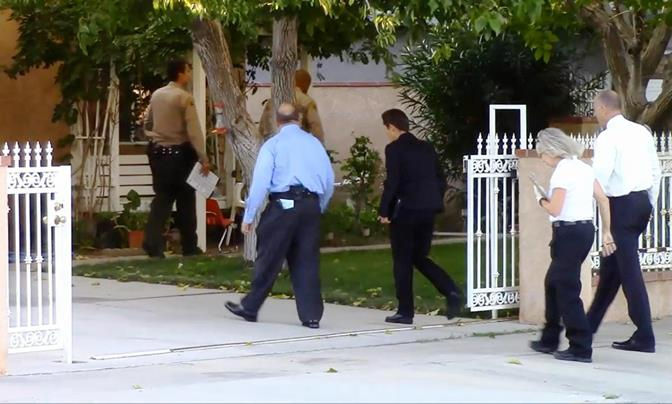 Homicide detectives spent all day Saturday at a Palmdale home in the 38700 block of 3rd Street East, where a woman was stabbed to death around 1:30 p.m. (Photo by LUIS MEZA)