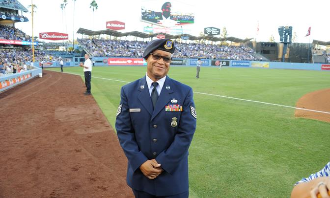 Tech. Sgt. Robert Sumner, 412th Security Forces Squadron, poses for a picture on the field during a L.A. Dodgers vs. New York Mets game Aug. 23. (Courtesy photo)